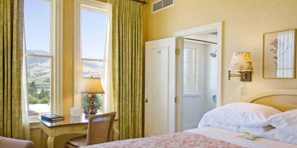 Beautifully appointed deluxe guest room with one Queen bed, offers sweeping views of Ashland and the surrounding mountains, as many of these rooms are located on the corner of the building.View Room