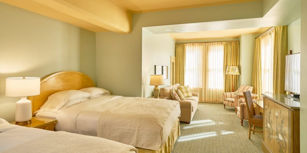 This is our most spacious accommodation and includes two queen beds, a cozy sitting area with a sofa bed and two armchairs.View Room